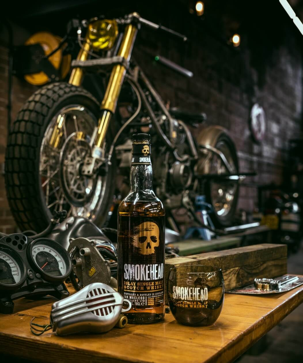A bottle of Smokehead in Tyler's workshop, with The Smoker under construction. Photo by Christopher Coates.