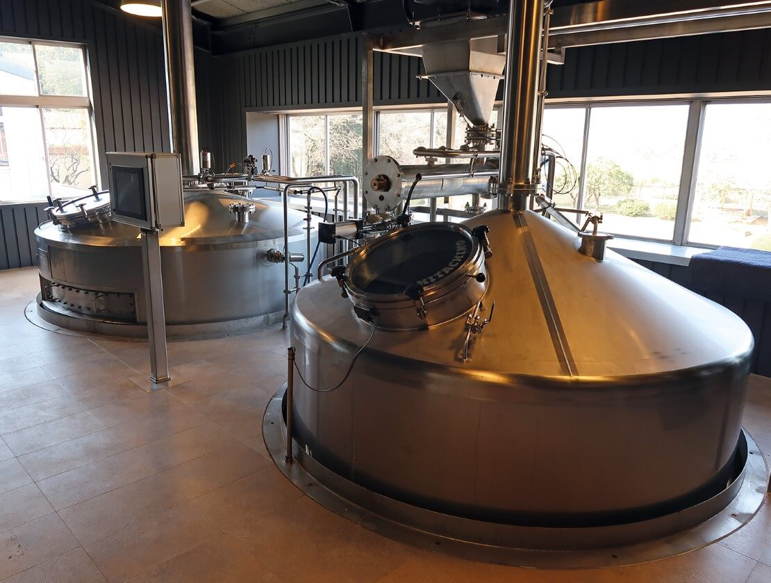 The mash room (with the mashtun in the front of the picture and the lauter tun in  the back)