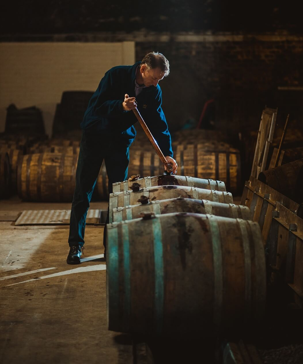 Sampling whisky from the cask
