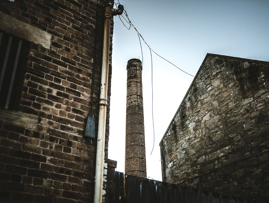 Outside the distillery chimney