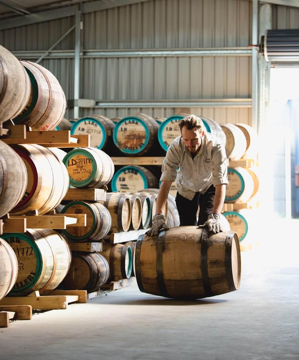 Rolling out casks at Lark Distillery