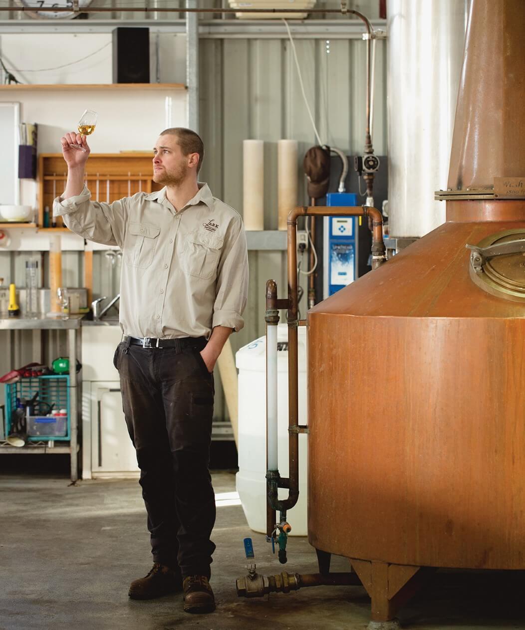 Checking the maturing spirit at Lark Distillery