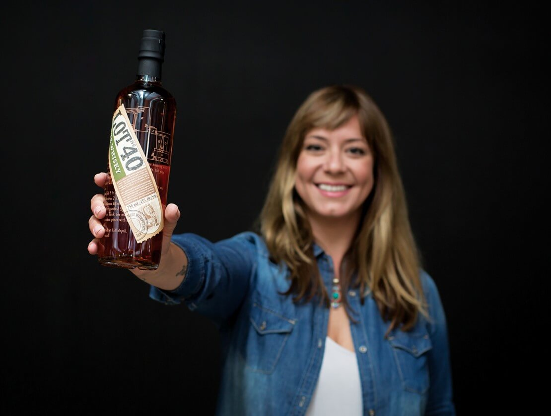 Lola Gegovic with a bottle of Lot 40