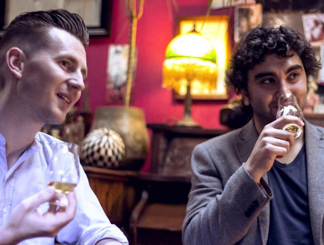 Felipe and Paul enjoy a dram.