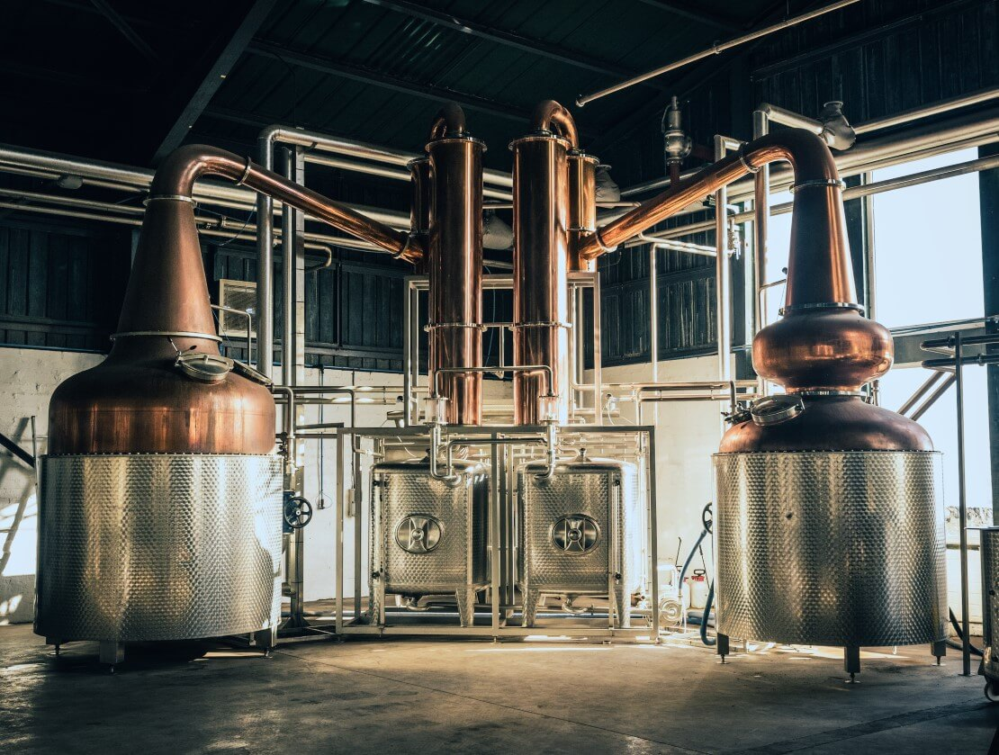 Two of Arbikie's copper pot stills, before the installation of the third.  Photo by Christopher Coates.